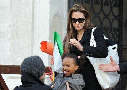 Brad Pitt, Zahara Jolie- Pitt, Angelina Jolie